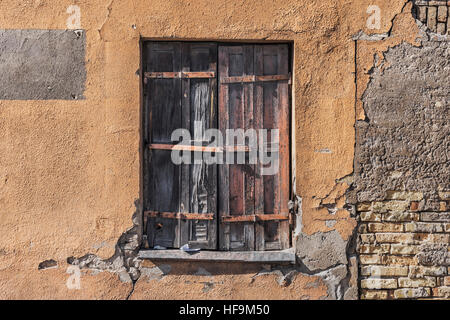 An old window at a derelict house in Vilnius, Lithuania, Baltic States, Europe - Stock Photo