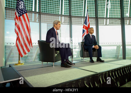 London Mayor Sadiq Khan sits with U.S. Secretary of State John Kerry as they hold a question-and-answer session - Stock Photo