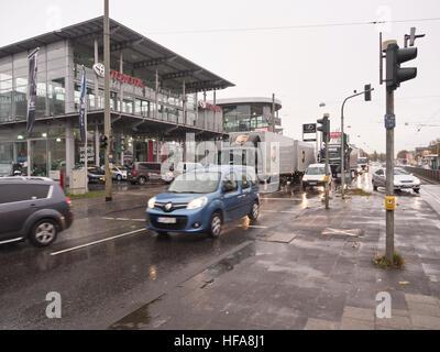 Heavy traffic on a wet and rainy day next to Toyota retailer, Hanauer Landstraße, Frankfurt am Main Hessen Germany - Stock Photo