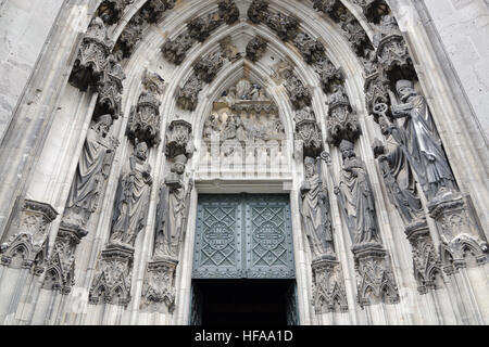 Cologne, Germany - September 17, 2015: The main entrance of the Cologne Cathedral shows the 19th century decoration. - Stock Photo