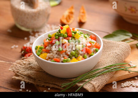 Barley salad and assorted vegetables in white bowl - Stock Photo