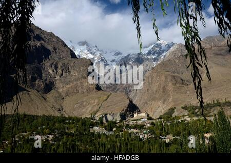 Karimabad town and Baltit Fort with mountains in Hunza Valley Gilgit Baltistan North Pakistan - Stock Photo