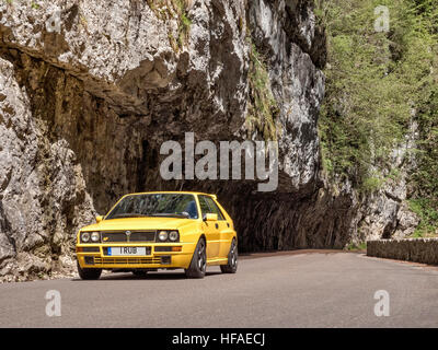 1995 Lancia Delta HF Integrale driving on roads in the French alps - Stock Photo