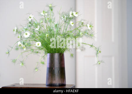 A Flower Display In A Glass Vase On A Pulpit In St Davids Church