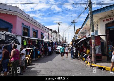 Busy street scene in Granada, NIcaragua - Stock Photo