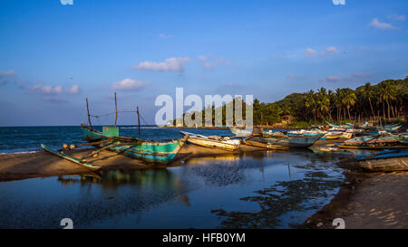 Arugam bay beach with traditional fisherman boat, Sri Lanka - Stock Photo
