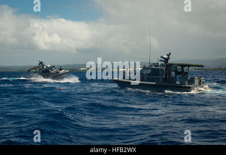Sailors assigned to Coastal Riverine Squadron (CORIVRON) 11 respond to a man overboard drill while participating - Stock Photo