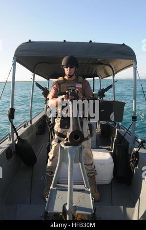 GUANTANAMO BAY, Cuba – U.S. Coast Guard Petty Officer 3rd Class Ryan Lewis, a waterside securityman with Maritime - Stock Photo