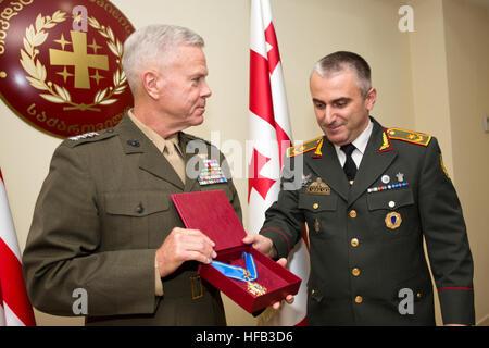 Commandant of the U.S. Marine Corps, Gen. James F. Amos, left, receives an award at Tbilisi, Georgia, Sept. 4, 2014. - Stock Photo