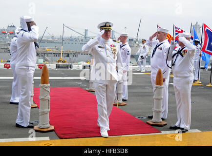 SAN DIEGO (June 6, 2014) – Capt. Clinton A. Carroll salutes as he is piped aboard for a change of command ceremony - Stock Photo