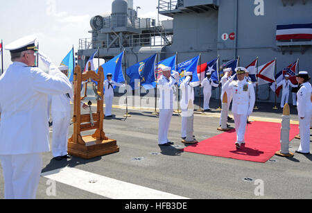 SAN DIEGO (June 6, 2014) – Capt. Shawn W. Lobree salutes as he is piped ashore after a change of command ceremony - Stock Photo