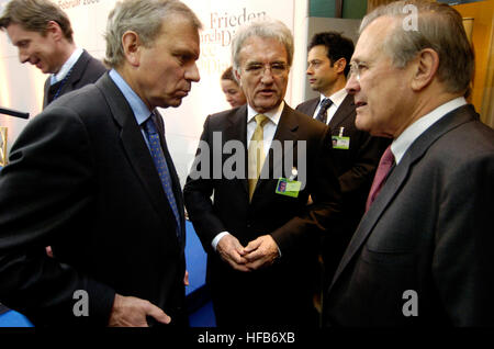 060204-N-0696M-259  Secretary of Defense Donald H. Rumsfeld (right) talks to NATO Secretary General Jaap de Hoop - Stock Photo