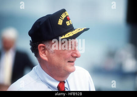 Edward I. Koch, mayor of New York City, sports a sailor's cap at the commissioning ceremony for the guided missile - Stock Photo
