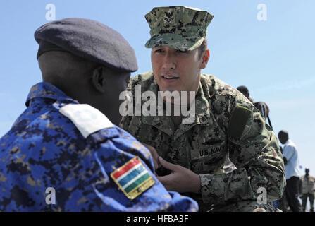 130307-N-IY142-232 DAKAR, Senegal (March 7, 2013) Hospital Corpsman 2nd Class Peter Wells discusses medical training - Stock Photo