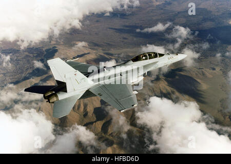 A US Navy (USN) F/A-18F Super Hornet aircraft assigned to the Air Test and Evaluation Squadron Nine (VX-9) conducts - Stock Photo