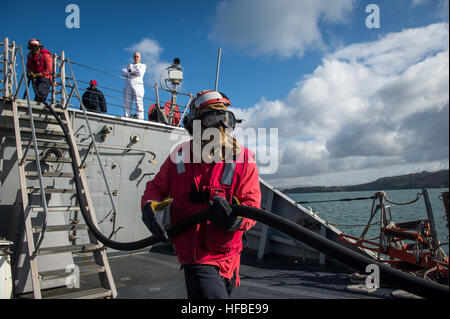150325-N-JN664-029 PLYMOUTH, England (March 25, 2015) Sailors aboard USS Donald Cook (DDG 75) participate in a simulated - Stock Photo