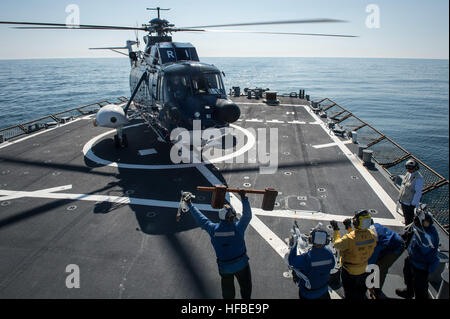 150406-N-JN664-093 ATLANTIC OCEAN (April 6, 2015) USS Donald Cook (DDG 75) concludes flight operations with a Sikorsky - Stock Photo