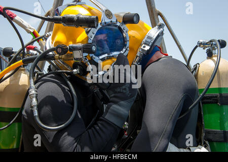 Chief Navy Diver Kenneth McMillion, left, and Command Master Chief Scott Brodeur, both assigned to Mobile Diving - Stock Photo