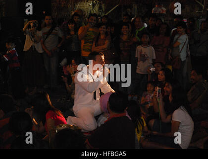 120603-N-HM950-038  SURABAYA, Indonesia (June 03, 2012) Musician 3rd Class Gabriel Brown engages the crowd during - Stock Photo