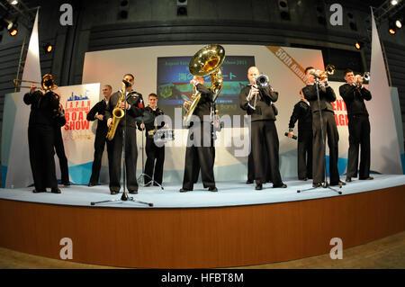 110304-N-MU720-003 YOKOHAMA, Japan (March 4, 2011) The U.S. 7th Fleet Orient Express Brass Band performs a solo - Stock Photo