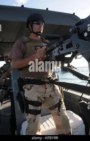 GUANTANAMO BAY, Cuba – U.S. Coast Guard Petty Officer 3rd Class Ryan Lewis, a waterside securityman deployed with - Stock Photo
