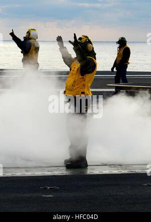 130125-N-TB177-081 ATLANTIC OCEAN (Jan. 25, 2013) Flight deck directors aboard the aircraft carrier USS George H.W. - Stock Photo