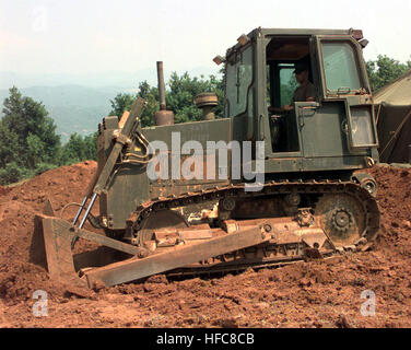 990616-N-6019M-509 TIRANA, Albania (June 16, 1999) -- Equipment Operator Constructionman Dan Lasich from Rosenberg, - Stock Photo