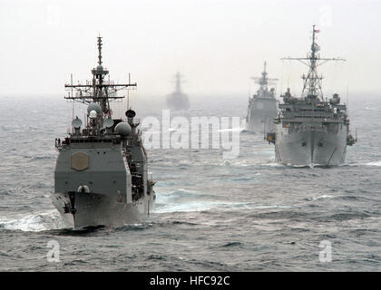 The US Navy (USN) Ticonderoga Class Guided Missile Cruiser USS LEYTE GULF (CG 55) (foreground), USN Austin Class - Stock Photo