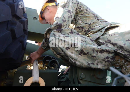 Utilitiesman Constructionman Edward Skeen, of Naval Mobile Construction Battalion 4, secures loose objects on a - Stock Photo