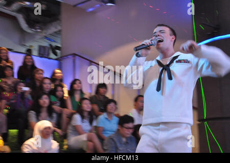 120512-N-SM668-066 JAKARTA, Indonesia (May 12, 2012) Musician 3rd Class Gabriel Brown of the U.S. 7th Fleet Band's - Stock Photo