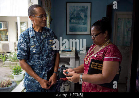 Adm. Cecil D. Haney, commander of the U.S. Pacific Fleet, left, presents Republic of Kiribati Minister of Foreign - Stock Photo