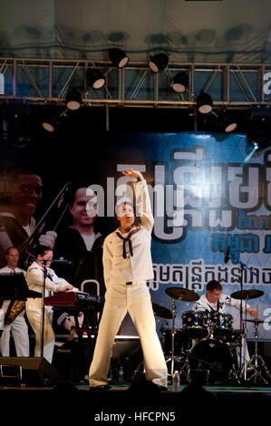Musician 3rd Class Gabriel Brown dances on stage during a performance by the U.S. 7th Fleet 'Far East Edition' rock - Stock Photo