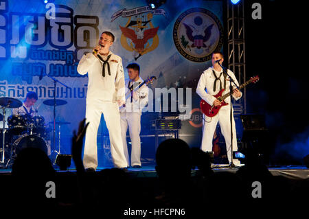 Sailors from the U.S. 7th Fleet 'Far East Edition' rock band, play at Teal Beach to a packed crowd. The band is - Stock Photo
