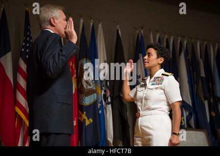 Secretary of the Navy Ray Mabus gives Vice Adm. Michelle Howard the oath of office before promoting her to the rank - Stock Photo