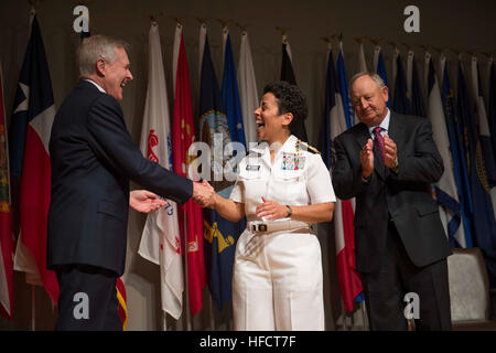 Secretary of the Navy Ray Mabus congratulates Adm. Michelle Howard after putting on her fourth star Tuesday, July - Stock Photo
