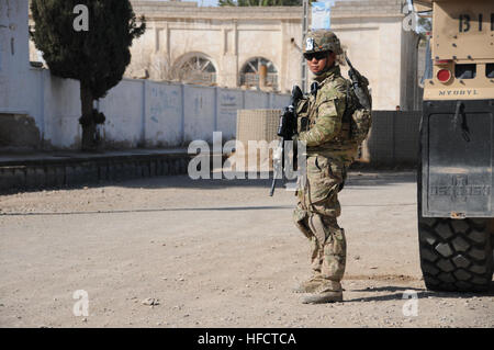 U.S Army Sgt. Calixto Inot, security force team member with Provincial Reconstruction Team (PRT) Farah, pulls security - Stock Photo