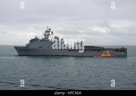 The amphibious dock landing ship USS Pearl Harbor passes under the Coronado Bridge as the ship returns to Naval - Stock Photo