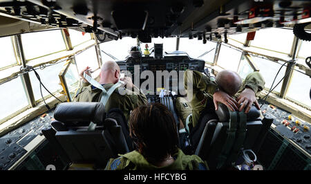 The crew of a Royal Canadian Air Force CC-130 Hercules, assigned to 435 Transport and Rescue Squadron, completes - Stock Photo