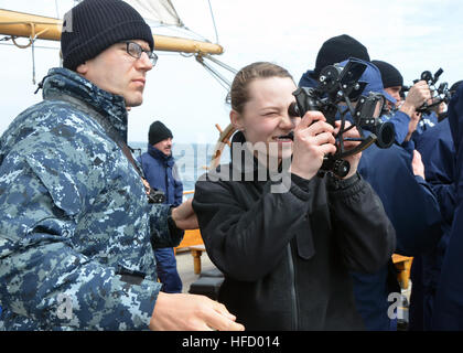 Lt. Julien Geiser, from Middletown, Pa., assigned to USS Constitution, teaches Seaman Brianna Bays, from Trenton, - Stock Photo