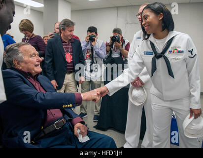 COLLEGE STATION, Texas (Nov. 12, 2016) Petty Officer 3rd Class Raylene Rodriguez meets President George H.W. Bush during a military appreciation football game at Texas A&M University. Rodriguez was selected as petty officer of the year aboard the aircraft carrier USS George H.W. Bush (CVN 77). The game is part of a two-day namesake trip to Texas where Sailors engaged with the local community about the importance of the Navy in defense and prosperity. (U.S. Navy photo by Seaman Joe Boggio/Released) 161112-N-SO730-295  Join the conversation: http://www.navy.mil/viewGallery.asp http://www.faceboo