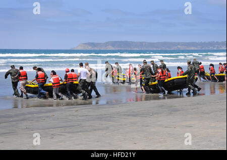 Basic Underwater Demolition (BUDS) candidates and San Diego students participate in surf passage at Naval Amphibious - Stock Photo