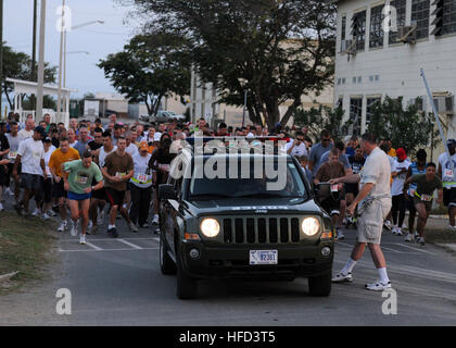 GUANTANAMO BAY, Cuba – Service members of Joint Task Force Guantanamo and Naval Station Guantanamo Bay take off - Stock Photo