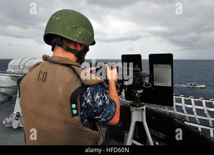 121011-N-ZE938-035 CARIBBEAN SEA (Oct. 11, 2012) Electronics Technician 3rd Class Casey Colding simulates firing - Stock Photo