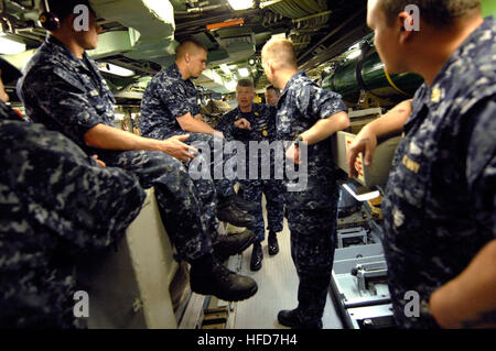 Master Chief Petty Officer of the Navy Rick West tours the Los Angeles-class attack submarine USS Philadelphia during - Stock Photo