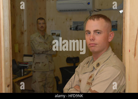 Newly frocked Chief Petty Officer Alan Grow of Bogalusa, La., assigned to the 30th Naval Construction Regiment, - Stock Photo