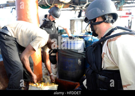 U.S. Navy Sonar Technician 1st Class Anthony Benz, foreground, and Electrician's Mate 2nd Class Brian Chance, background, - Stock Photo
