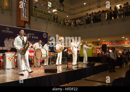 The U.S. 7th Fleet Band's Far East Edition Brass Band performs at SM Mega Mall, in front of an audience of more - Stock Photo
