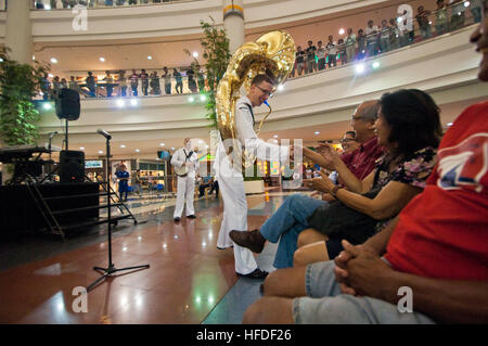Musician 3rd Class Zachary Buckwash, assigned to the U.S. 7th Fleet Band, Far East Edition Brass Band, interacts - Stock Photo