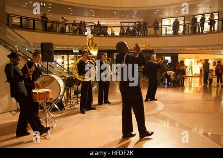 U.S. 7th Fleet Band members perform for locals at the Harbour City Mall in Hong Kong. Sailors from the U.S. 7th - Stock Photo