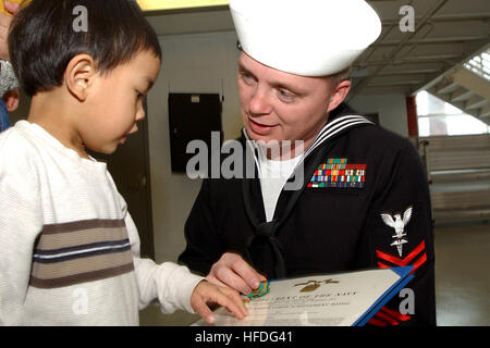 020215-N-5576W-001 Great Lakes, IL. (Feb. 19, 2002) -- Hospital Corpsman 2nd Class Billy Carver shows his Navy Achievement - Stock Photo